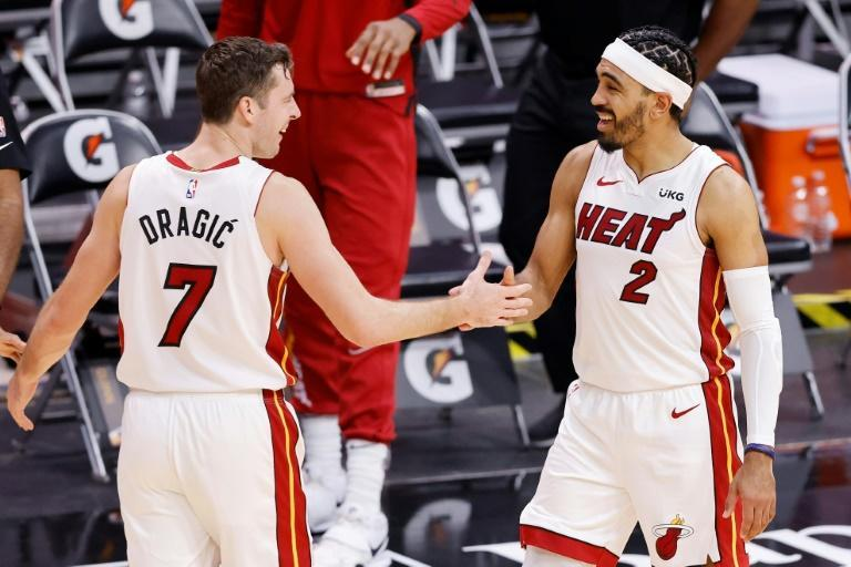 Miami's Goran Dragic celebrates with teammate Gabe Vincent after the Heat's 119-108 NBA victory over the Milwaukee Bucks
