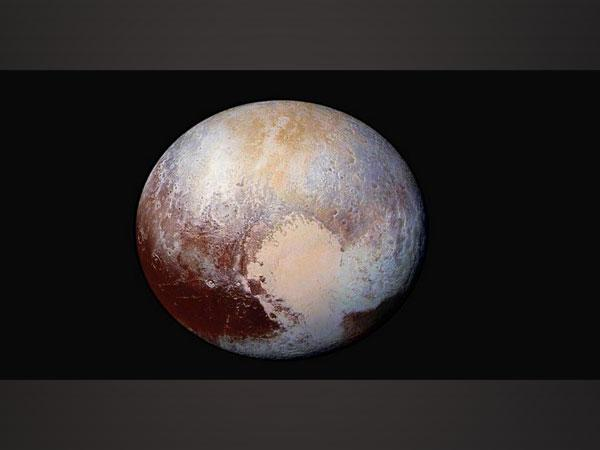 Enhanced colour global view of Pluto. (Image Source: NASA/Johns Hopkins APL/Southwest Research Institute)