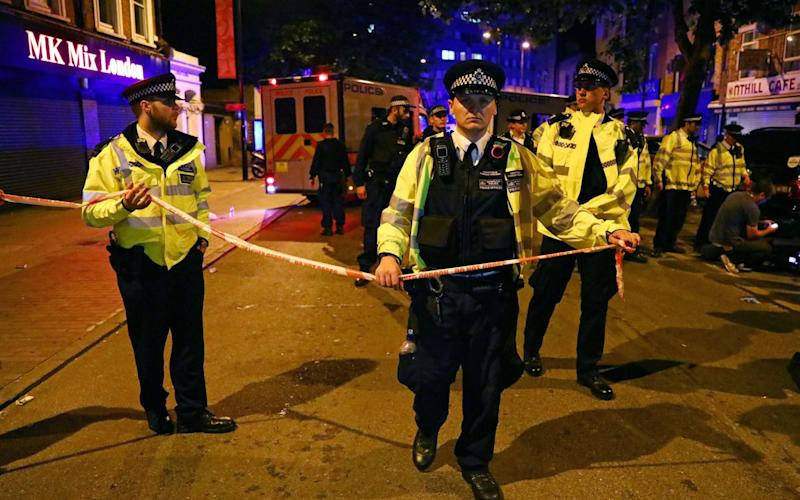 Police officers attend to the scene after a vehicle collided with pedestrians in Finsbury Park - Credit: Reuters