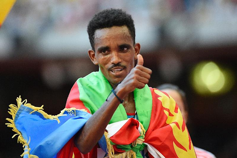 Eritrea's Ghirmay Ghebreslassie celebrates winning the men's marathon during the IAAF World Championships, at the 'Bird's Nest' National Stadium in Beijing, on August 22, 2015 (AFP Photo/Olivier Morin)