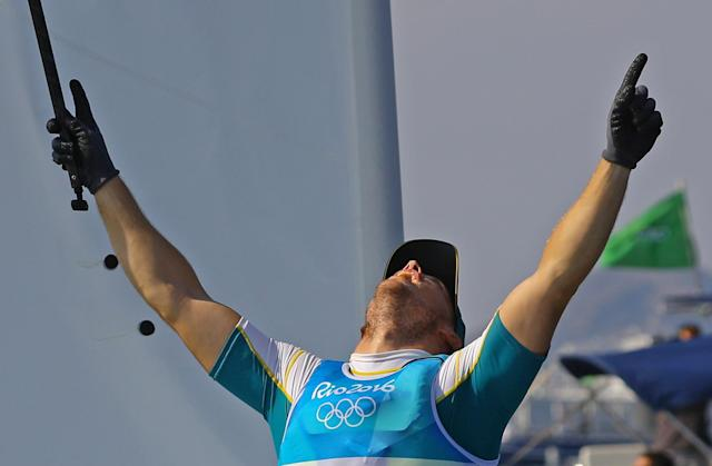 2016 Rio Olympics - Sailing - Final - Men's One Person Dinghy - Laser - Medal Race - Marina de Gloria - Rio de Janeiro, Brazil - 16/08/2016. Tom Burton (AUS) of Australia celebrates gold medal. REUTERS/Brian Snyder TPX IMAGES OF THE DAY FOR EDITORIAL USE ONLY. NOT FOR SALE FOR MARKETING OR ADVERTISING CAMPAIGNS.