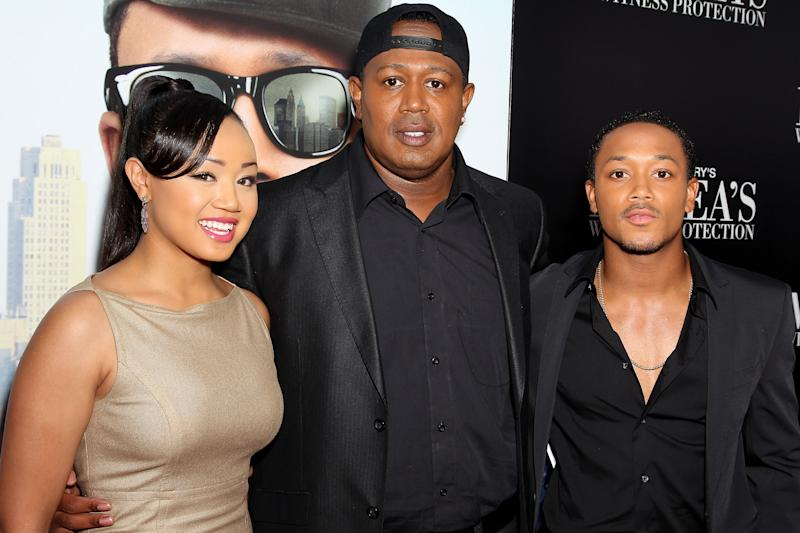 """This June 25, 2012 photo released by Starpix shows rapper-turned actor Romeo, right, his sister Cymphonique Miller, left, and their father hip hop artist Master P., at the premiere of Romeo's film, """"Tyler Perry's Madea's Witness Protection,"""" in New York. Romeo says his hip-hop artist dad and filmmaker Tyler Perry have a similar work ethic and outlook on life. Perry directs and stars alongside Romeo in his latest comedy, """"Tyler Perry's Madea's Witness Protection,"""" in theaters Friday.  (AP Photo/Starpix, Marion Curtis)"""