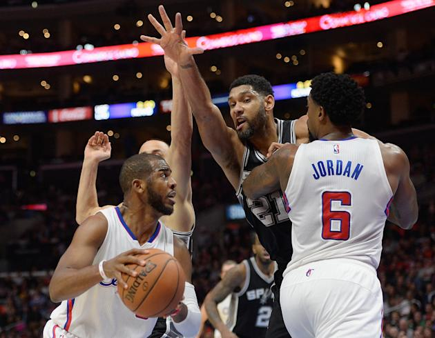 LOS ANGELES, CA - FEBRUARY 19: Tim Duncan #21 of the San Antonio Spurs chases Chris Paul #3 of the Los Angeles Clippers around the screen of DeAndre Jordan #6 at Staples Center on February 19, 2015 in Los Angeles, California. NOTE TO USER: User expressly acknowledges and agrees that, by downloading and or using this Photograph, user is consenting to the terms and condition of the Getty Images License Agreement. (Photo by Harry How/Getty Images)