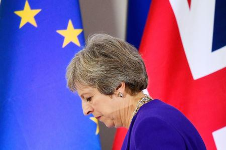 FILE PHOTO: Britain's Prime Minister Theresa May leaves a news conference at the European Union leaders summit in Brussels