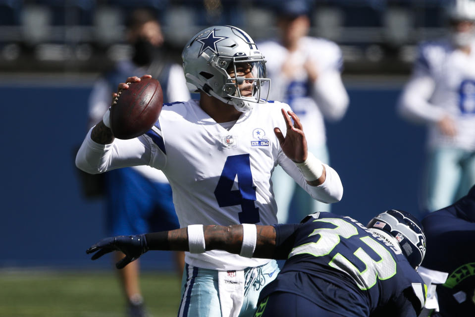 Sep 27, 2020; Seattle, Washington, USA; Dallas Cowboys quarterback Dak Prescott (4) passes against the Seattle Seahawks during the first quarter at CenturyLink Field. Mandatory Credit: Joe Nicholson-USA TODAY Sports