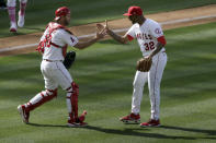 Los Angeles Angels relief pitcher Raisel Iglesias, right, celebrates with catcher Drew Butera after the team's 2-1 win over the Los Angeles Dodgers in a baseball game in Anaheim, Calif., Sunday, May 9, 2021. (AP Photo/Alex Gallardo)