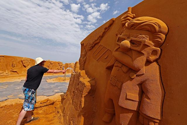 "<p>Sand carver Teimur Abdul Ganiev from Russia works on a sculpture during the Sand Sculpture Festival ""Disney Sand Magic"" in Ostend, Belgium June 22, 2017. (Yves Herman/Reuters) </p>"