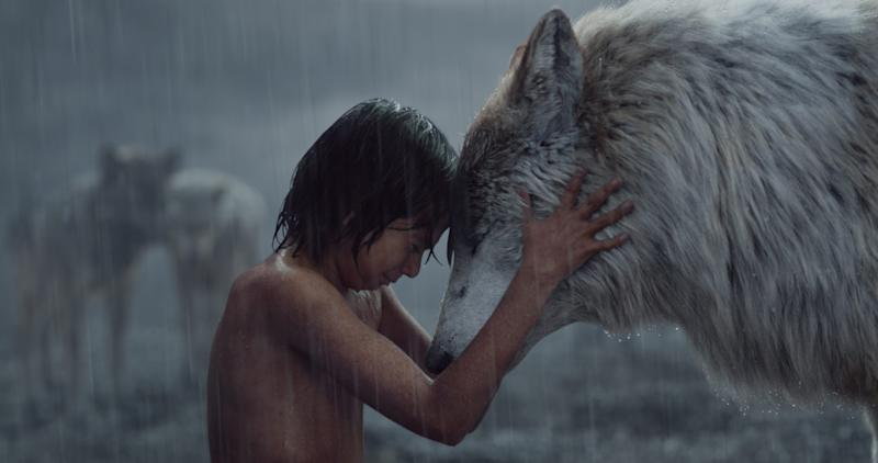 """Mowgli (Neel Sethi) shares a moment with his wolf mom Raksha (voiced by Lupita Nyong'o), one of the many photorealistic animals in Jon Favreau's """"The Jungle Book.'"""
