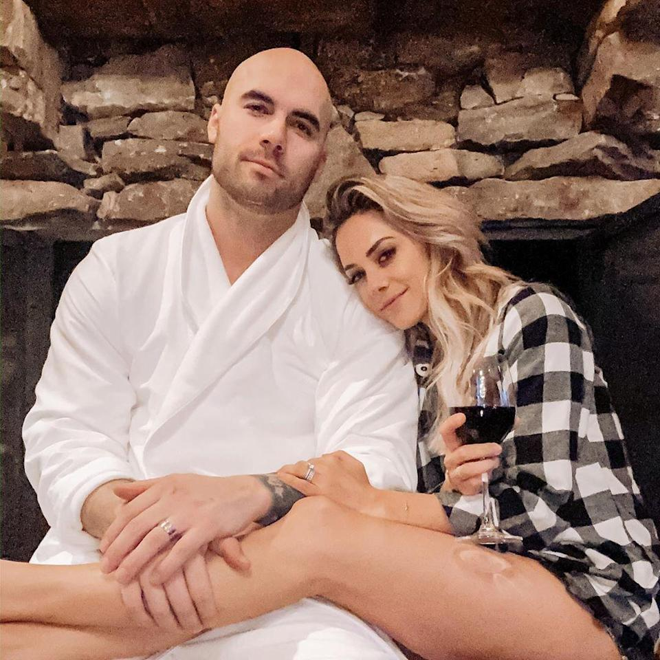 """<p>During an October 2019 episode of their podcast <a href=""""http://ihr.fm/WhineDown"""" rel=""""nofollow noopener"""" target=""""_blank"""" data-ylk=""""slk:Whine Down with Jana Kramer and Mike Caussin"""" class=""""link rapid-noclick-resp""""><i>Whine Down with Jana Kramer and Mike Caussin</i></a>, the pair opened up about an incident involving the singer going through Caussin's Apple Watch and finding a topless woman's photo that he had deleted from his phone without informing his wife.</p> <p>""""I see it and I know the right thing to do is to go get Jana, pull her aside and say, 'Hey. I just received this. I don't know what the hell it is but I just need you to know.' I was terrified to do so,"""" Caussin recalled.</p> <p>""""Jana and I have had a really good run recently, like not a lot of past stuff coming up, we've been handling situations pretty well, handling triggers pretty well, talking things out,"""" he added. """"It really felt like we were really building a lot of forward momentum."""" </p> <p>However, not telling his wife backfired.</p> <p>""""When I looked, I was like, 'Goddamnit.' I saw it and my heart just fell. It's here. It's happened again,"""" Kramer said. """"I'm such an f—ing idiot, and I immediately called my best friend and I was just shaking crying outside.""""</p> <p>In the end, Caussin apologized to his wife on-air. """"I am sorry honey that I didn't handle it the way that we agreed upon. I didn't handle it the right way for myself, for you, for both of us,"""" he said.</p>"""
