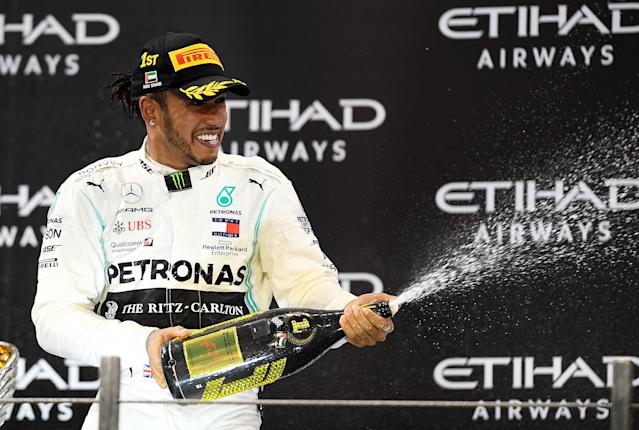 ABU DHABI, UNITED ARAB EMIRATES - DECEMBER 01: Race winner Lewis Hamilton of Great Britain and Mercedes GP celebrates on the podium during the F1 Grand Prix of Abu Dhabi at Yas Marina Circuit on December 01, 2019 in Abu Dhabi, United Arab Emirates. (Photo by Clive Mason/Getty Images)