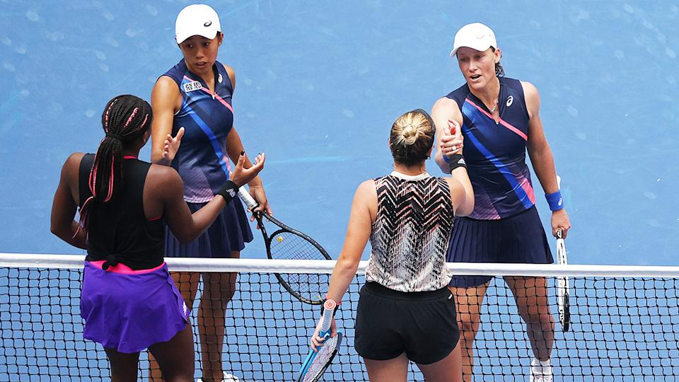 Sam Stosur and Zhang Shuai, pictured here shaking hands with Coco Gauff and Catherine McNally.