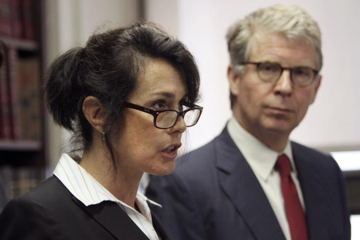 This June 17, 2011 file photo shows Manhattan District Attorney Cyrus R. Vance Jr., right, while New York City Police Department Narcotics Inspector Lori Pollock speaks to reporters during a news conference. Pollock, a former chief who was one of the NYPD's highest-ranking female police officials, accused the department of denying women the opportunity to advance to senior leadership posts in a federal lawsuit. / Credit: Mary Altaffer / AP