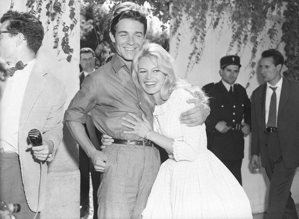 <p>Brigitte Bardot and her second husband, Jacques Charrier, embrace after their wedding in Louveciennes, France. The actress and her <em>Babette Goes to War </em>costar were married at the registry office in the small French town.</p>