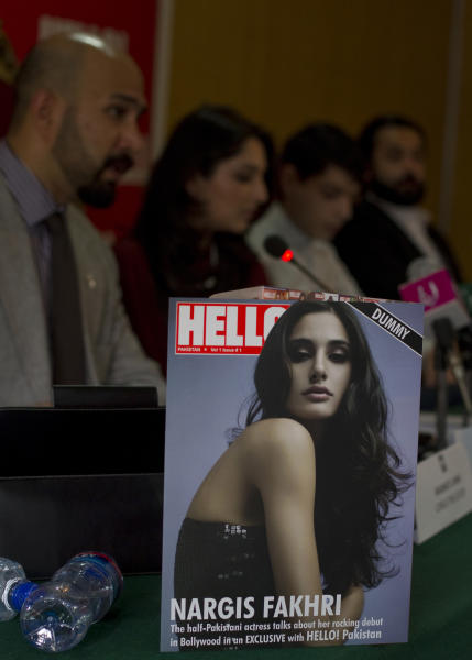 The editorial staff of Hello magazine address a news conference during its launching ceremony at National Press Club in Islamabad, Pakistan on Saturday, March 24, 2012. Pakistan is better known for bombs than bombshells, militant compounds than opulent estates. A few enterprising Pakistanis hope with the launch of a local version of the well-known celebrity magazine Hello! (AP Photo/B.K. Bangash)