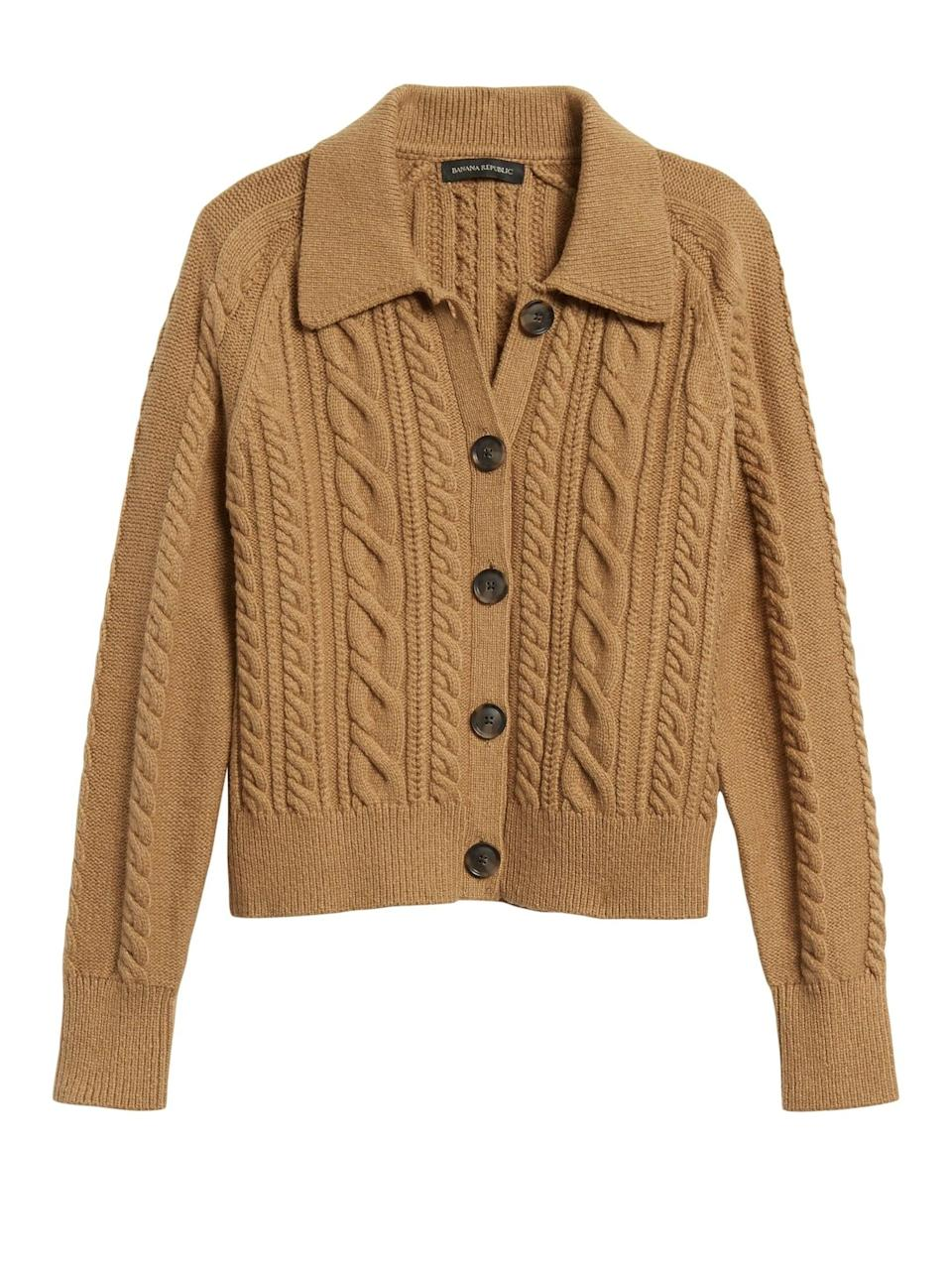<p>Swap your blazer for this cozy <span>Banana Republic Heritage Cable-Knit Cardigan Sweater</span> ($103, originally $129).</p>