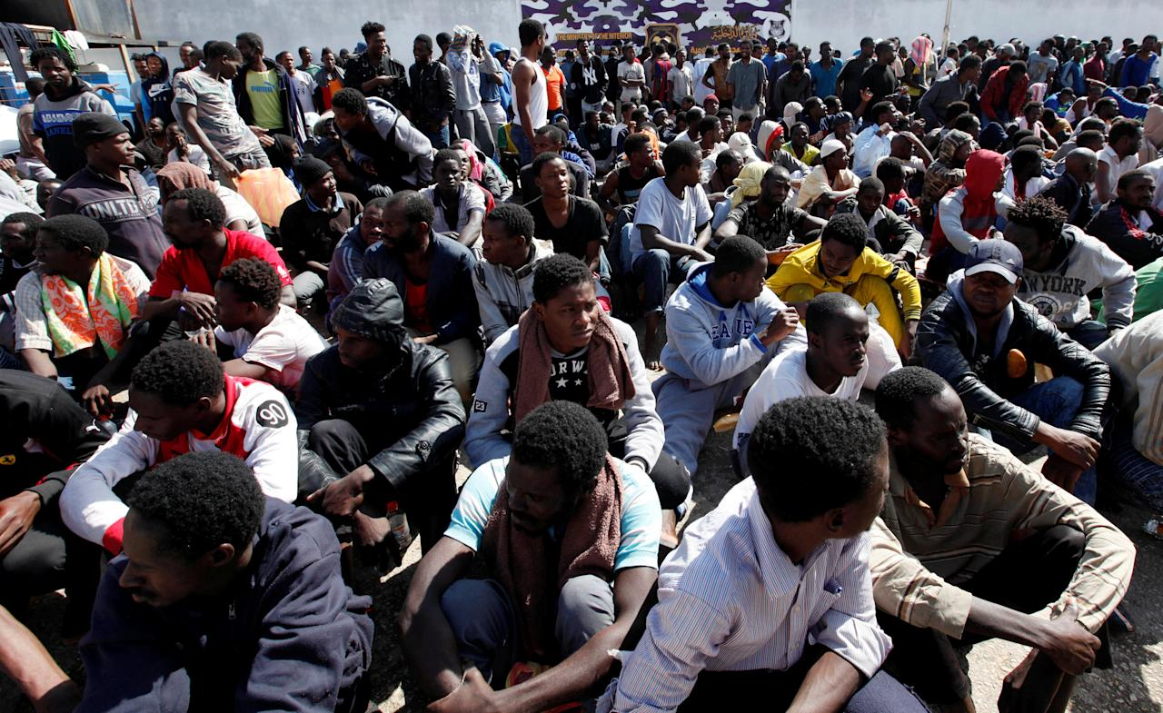 Illegal African migrants sit during a visit by U.N. Special Representative and Head of the United Nations Support Mission in Libya Martin Kobler and International Organization for Migration Director General William Lacy Swing at a detention camp in Tripoli, Libya, March 22, 2017. REUTERS/Ismail Zitouny