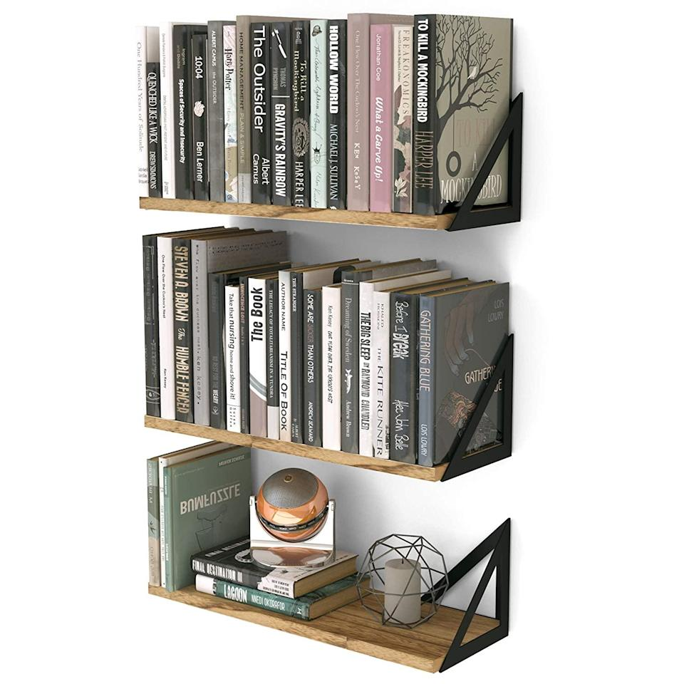 """<h2>Floating Shelves</h2><br>A floating bookshelf is a great way to save room and proudly display your collection of magazines, novels, etc. in a smaller living space. <br><br><em>Shop</em> <a href=""""https://amzn.to/3m5H1me"""" rel=""""nofollow noopener"""" target=""""_blank"""" data-ylk=""""slk:Wallniture"""" class=""""link rapid-noclick-resp""""><strong><em>Wallniture</em></strong></a><br><br><strong>Wallniture</strong> Minori Floating Shelves Set of 3, $, available at <a href=""""https://amzn.to/3khorXw"""" rel=""""nofollow noopener"""" target=""""_blank"""" data-ylk=""""slk:Amazon"""" class=""""link rapid-noclick-resp"""">Amazon</a>"""