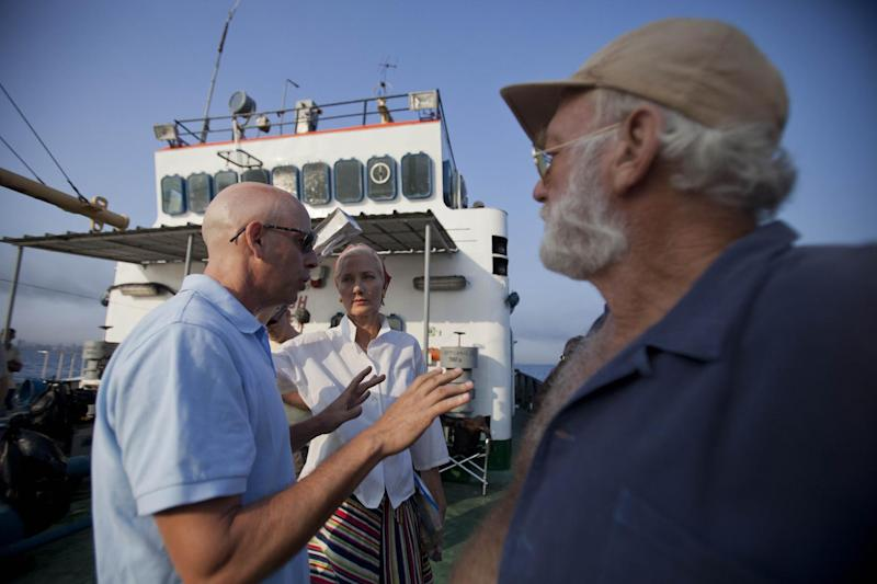 "In this April 24, 2014 photo, film director Bob Yari, left, works with actors Joely Richardson, center, and Adrian Sparks, right, during the filming of the movie ""Papa"" in Havana bay, Cuba. Though the title derives from the Nobel Prize-winning novelist's nickname, the movie is based on an autobiographical script by Denne Bart Petitclerc, who is played by Giovanni Ribisi, while Hemingway is portrayed by theater and screen veteran Adrian Sparks. (AP Photo/Yesica Fish)"