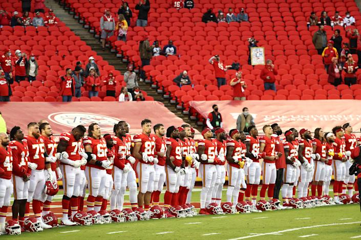 Members of the Kansas City Chiefs stand united for with locked arms before their 2020 NFL season opener Thursday against the Houston Texans at Arrowhead Stadium in Kansas City, Missouri. (Jamie Squire/Getty Images)