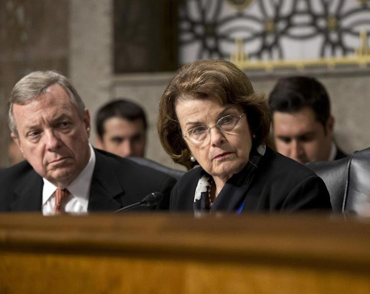 Sen. Dianne Feinstein, D-Calif., right, chair of the Senate Intelligence Committee, right, and Sen. Dick Durbin, D-Ill., listen to testimony from Gen. Keith B. Alexander, director of the National Security Agency and head of the U.S. Cyber Command, as he answers questions from lawmakers on Capitol Hill in Washington, Wednesday, June 12, 2013, before the Senate Appropriations Committee. (AP Photo/J. Scott Applewhite)