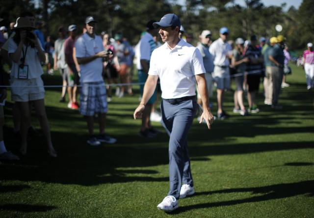 Rory McIlroy of Northern Ireland walks past patrons as he heads to the 8th tee during practice for the 2018 Masters golf tournament at Augusta National Golf Club in Augusta, Georgia, U.S. April 2, 2018. REUTERS/Mike Segar