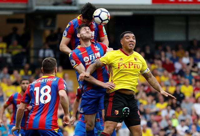 """Soccer Football - Premier League - Watford v Crystal Palace - Vicarage Road, Watford, Britain - April 21, 2018 Watford's Troy Deeney in action with Crystal Palace's Joel Ward and James Tomkins Action Images via Reuters/Paul Childs EDITORIAL USE ONLY. No use with unauthorized audio, video, data, fixture lists, club/league logos or """"live"""" services. Online in-match use limited to 75 images, no video emulation. No use in betting, games or single club/league/player publications. Please contact your account representative for further details."""
