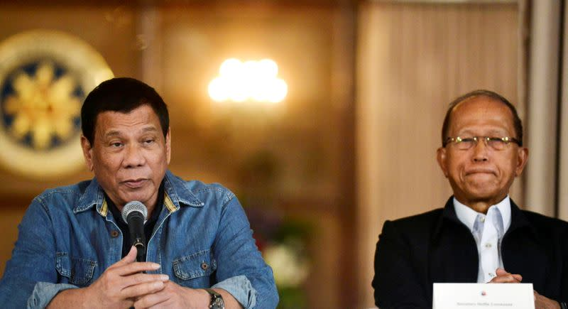 FILE PHOTO: Philippine President Rodrigo Duterte announces the disbandment of police operations against illegal drugs next to Defence Secretary Delfin Lorenzana at the Malacanang palace in Manila