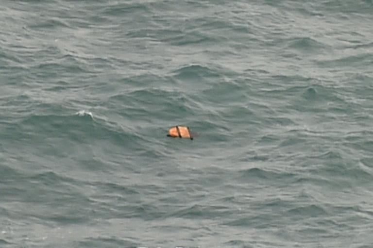 Photo taken from an Indonesian search and rescue aircraft over the Java Sea shows possible plane debris from missing AirAsia flight QZ8501 on December 30, 2014