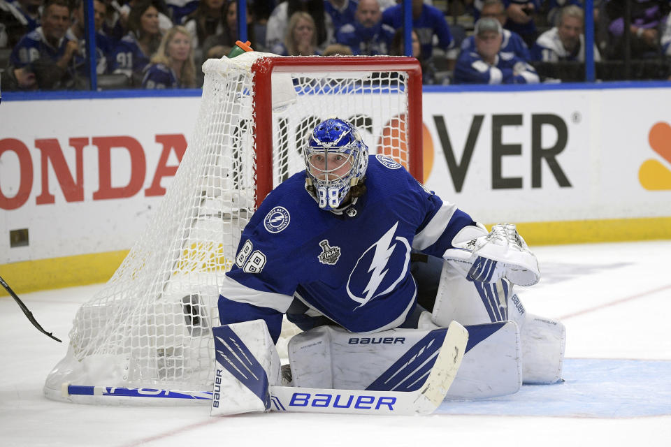 FILE - In this July 7, 2021, file photo, Tampa Bay Lightning goaltender Andrei Vasilevskiy (88) guards the net during the third period of Game 5 of the NHL hockey Stanley Cup finals series against the Montreal Canadiens in Tampa, Fla. (AP Photo/Phelan M. Ebenhack, File)