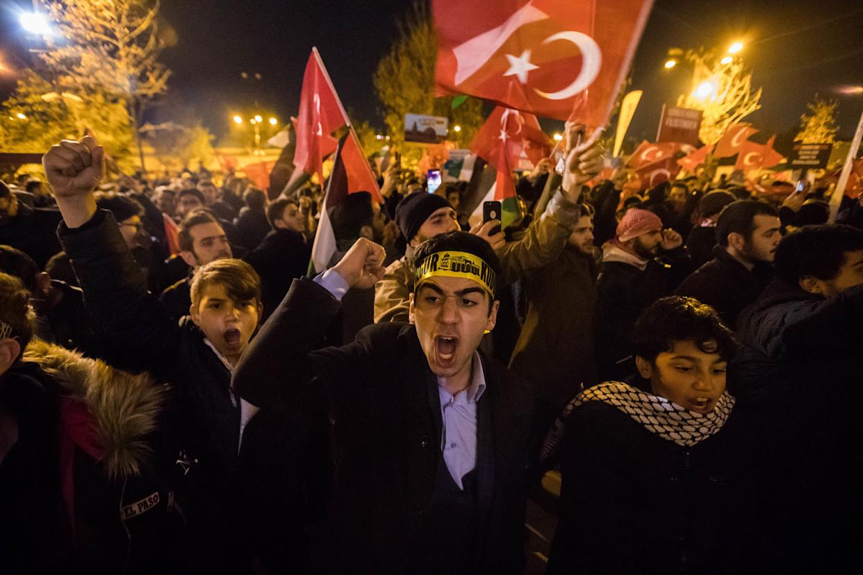 Protestors brandish Turkish flags during a protest against the Israel at Fatih Mosque in Istanbul, Turkey, 06 December 2017.