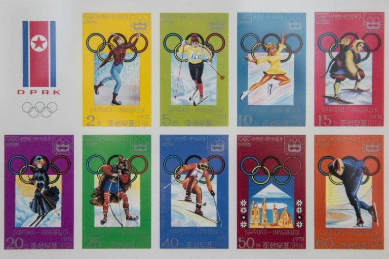 A selection of stamps commemorating North Korea's participation in past winter Olympic Games is displayed at a stamp shop in Pyongyang