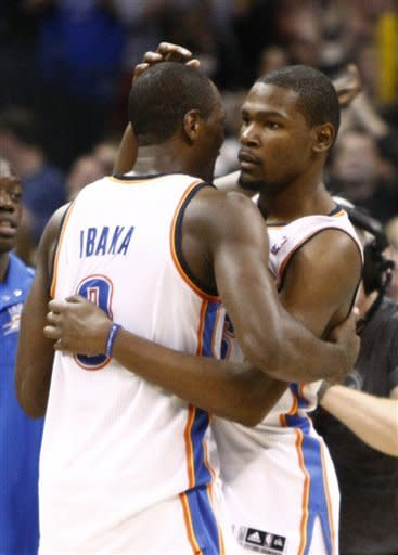 Oklahoma City Thunder's Serge Ibaka, left, and Kevin Durant, right, celebrate after Durant made a 3-pointer to win the game against the Dallas Mavericks in the final seconds of an NBA basketball game in Oklahoma City, Thursday, Dec. 29, 2011. Oklahoma City won 104-102. (AP Photo/Alonzo Adams)