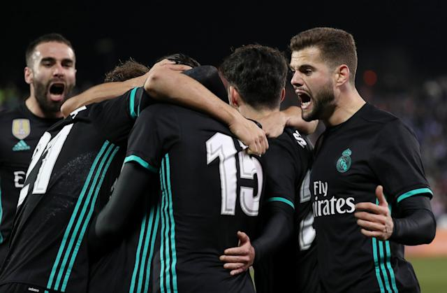 Soccer Football - Spanish King's Cup - Leganes vs Real Madrid - Quarter-Final - First Leg - Butarque Municipal Stadium, Leganes, Spain - January 18, 2018 Real Madrid's Marco Asensio celebrates scoring their first goal with Nacho and teammates REUTERS/Susana Vera