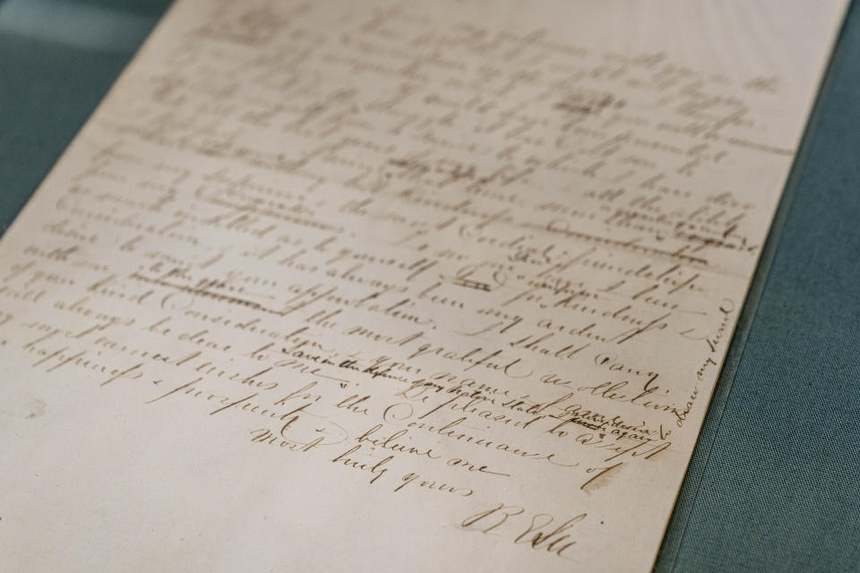 The letter by Robert E. Lee resigning from the U.S. Army to join the south in the Civil War is displayed at a museum building at Arlington House, The Robert E. Lee Memorial, formerly named the Custis-Lee Mansion, which reopens to the public for the first time since 2018 at Arlington National Cemetery, Tuesday, June 8, 2021 in Arlington, Va. The Virginia mansion where Robert E. Lee once lived that now overlooks Arlington National Cemetery is open to the public again, after a $12 million rehabilitation and reinterpretation that includes an increased emphasis on those who were enslaved there. (AP Photo/Andrew Harnik)