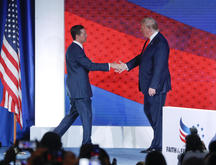President Donald Trump, right, greets Ralph Reed, left, founder and chairman of the Faith & Freedom Coalition, before speaking at the Faith & Freedom Coalition conference in Washington, Wednesday, June 26, 2019. (AP Photo/Pablo Martinez Monsivais)