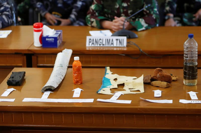 Debris from the missing submarine are displayed during media conference at Ngurah Rai Airport in Bali