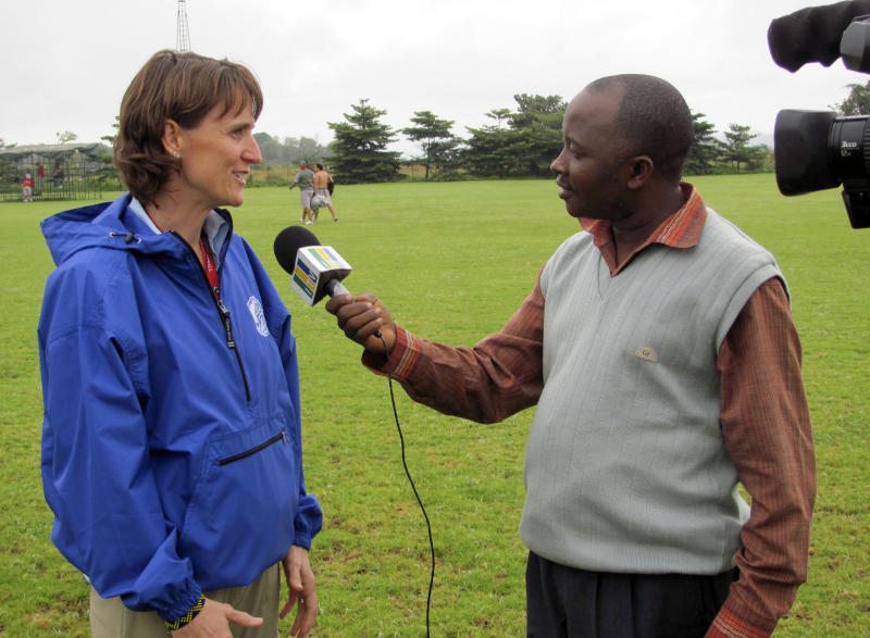 In this image provided by Global Football,  Drake University athletic director Sandy Hatfield-Clubb interviewed by a television journalist for the Kilimanjaro Bowl college football game, Thursday, May 19, 2011 in Arusha, Tanzania. The game, featuring Drake University against an all-star squad from a collection of private universities in Mexico, is scheduled to be played on Saturday, May 21.  (AP Photo/Global Football)