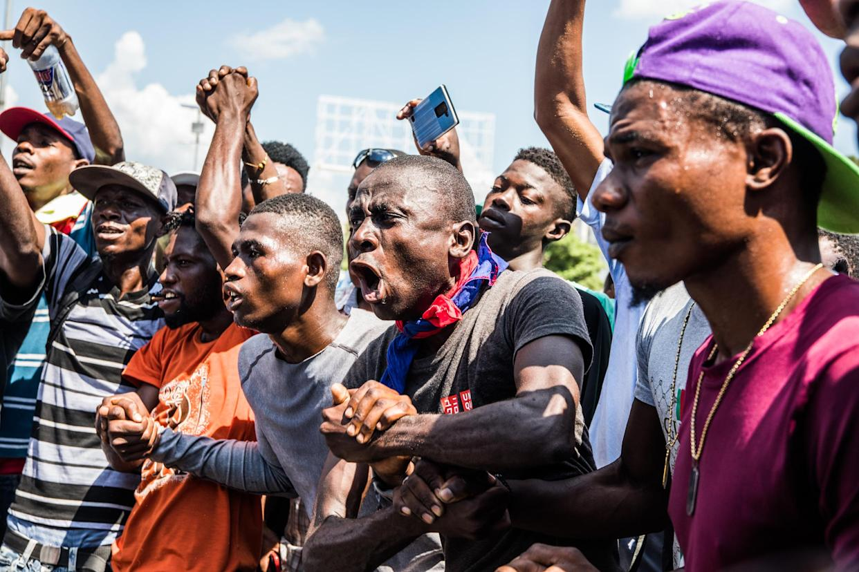 Demonstrators take part in a Voodoo ceremony before marching in the protest demanding the resignation of President Jovenel Moïse in Port-au-Prince on October 17, 2019. (Photo by VALERIE BAERISWYL/AFP via Getty Images)