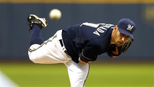Marco Estrada of the Milwaukee Brewers follows through on a pitch during the first inning of a baseball game Monday, May 7, 2012, in Milwaukee. (AP PhotoTom Lynn)