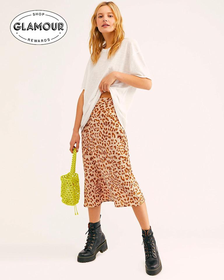 "This <a href=""https://www.glamour.com/story/best-leopard-print-midi-skirts?mbid=synd_yahoo_rss"">trend</a> won't stop until <em>everyone</em> has one in their closet—which, we don't mind, since these skirts are pretty cute and look great with any and all turtlenecks. Plus, you can shop them through <a href=""https://www.glamourrewards.com/"" rel=""nofollow""><em>Glamour</em> Rewards</a> and get cash back. $98, Free People. <a href=""https://www.freepeople.com/shop/normani-bias-printed-skirt/?color=029&size=US%202&inventoryCountry=US&countryCode=US&&mrkgcl=720&mrkgadid=3303018362&product_id=48967160&utm_term=48967160&utm_content=Bottoms&adpos=1o3&creative=191720237510&device=c&matchtype=&network=g&gclid=Cj0KCQjws7TqBRDgARIsAAHLHP47R3VbcTQz_elQ-GrVJQ4rGSBtekVjfrhRHZ1E2nesgrQkU-VwunEaAsaAEALw_wcB&gclsrc=aw.ds"">Get it now!</a>"