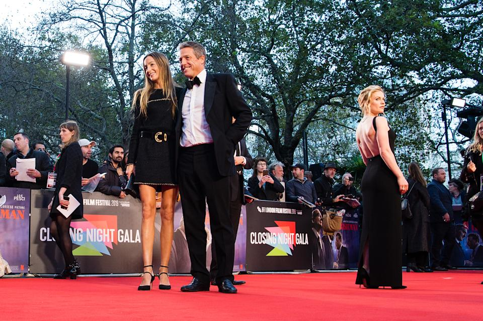"""LONDON, ENGLAND - OCTOBER 13: (L-R) Anna Elisabet Eberstein, Hugh Grant and Anna Paquin attend """"The Irishman"""" International Premiere and Closing Gala during the 63rd BFI London Film Festival at the Odeon Luxe Leicester Square on October 13, 2019 in London, England. (Photo by Jeff Spicer/Getty Images)"""