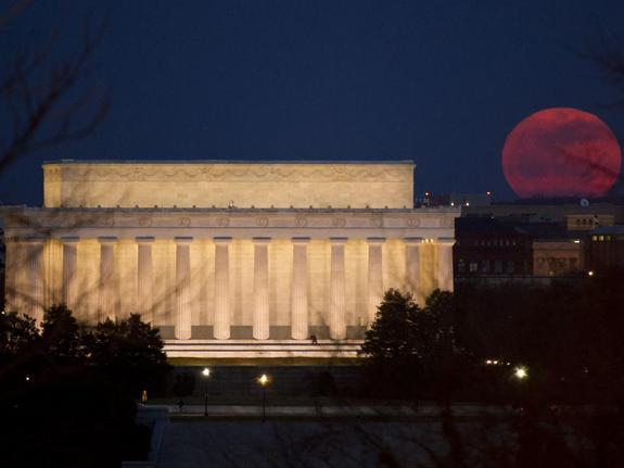 The full moon is seen as it rises near the Lincoln Memorial, Saturday, March 19, 2011, in Washington. The full moon tonight is called a super perigee moon since it is at its closest to Earth in 2011. The last full moon so big and close to Earth