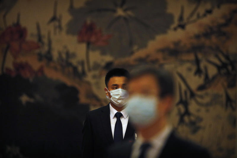 A security officer wearing a face mask to protect against the new coronavirus stands guard before the opening session of the Chinese People's Political Consultative Conference (CPPCC) at the Great Hall of the People in Beijing, Thursday, May 21, 2020. (AP Photo/Andy Wong, Pool)