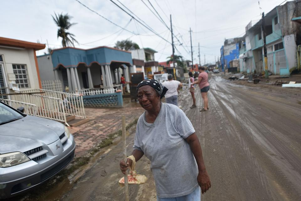 Maria Lopez cries while walking from her house that was flooded after the passage of Hurricane Maria, in Toa Baja, Puerto Rico, on September 22, 2017. Puerto Rico battled dangerous floods Friday after Hurricane Maria ravaged the island, as rescuers raced against time to reach residents trapped in their homes and the death toll climbed to 33. Puerto Rico Governor Ricardo Rossello called Maria the most devastating storm in a century after it destroyed the US territory's electricity and telecommunications infrastructure.  / AFP PHOTO / HECTOR RETAMAL        (Photo credit should read HECTOR RETAMAL/AFP/Getty Images)