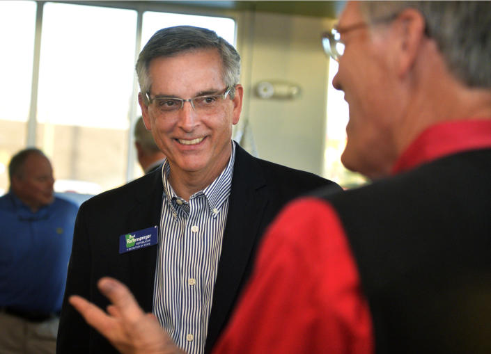 Republican Secretary of State candidate Brad Raffensperger greets supporters during a campaign stop in Augusta, Ga., Thursday, Nov. 29, 2018. Raffensperger and Democrat John Barrow are vying in a Dec. 4 runoff for Georgia secretary of state. (Michael Holahan/The Augusta Chronicle via AP)