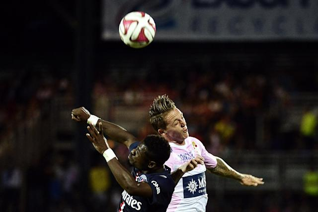 Paris Saint-Germain's French defender Serge Aurier (L) heads the ball with Evian TG's Danish forward Nicki Nielsen during the match between Evian Thonon Gaillard and Paris Saint-Germain in Annecy, France, on August 22, 2014 (AFP Photo/Jeff Pachoud)