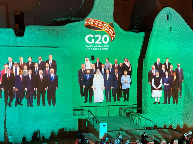 """Family Photo"" for annual G20 Summit World Leaders is projected onto Salwa Palace in At-Turaif, one of Saudi Arabia's UNESCO World Heritage sites, in Diriyah"