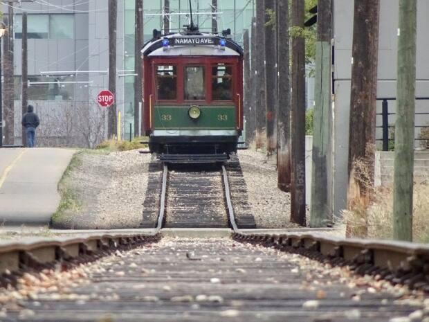 The Edmonton Radial Railway Society is finishing construction on a long-awaited extension to Whyte Avenue with hopes it will be completed by the end of July. (John Robertson/CBC - image credit)