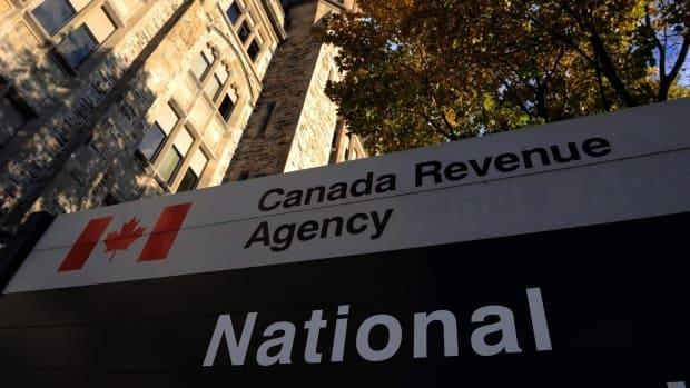 Police say one of the accused claimed to be from the Canada Revenue Agency on the phone and told the woman to hand over $10,000 or she'd be arrested. (CBC - image credit)