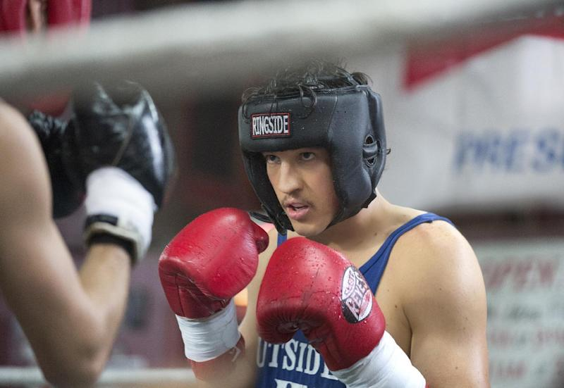 """In this image released by Open Road Films, Miles Teller appears in a scene from the film, """"Bleed For This."""" (Seacia Pavao/Open Road Films via AP)"""